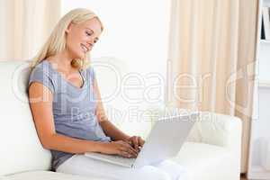 Serene woman using a laptop
