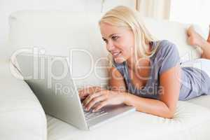 Lying woman using a laptop