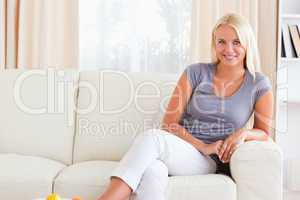 Smiling woman sitting on a sofa