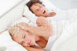 Woman awaken by her boyfriend's snoring