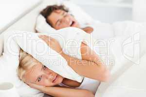 Woman awaken by her husband's snoring