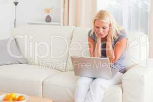 Upset woman using a laptop