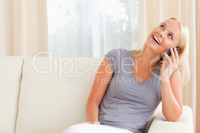 Laughing woman speaking on the phone