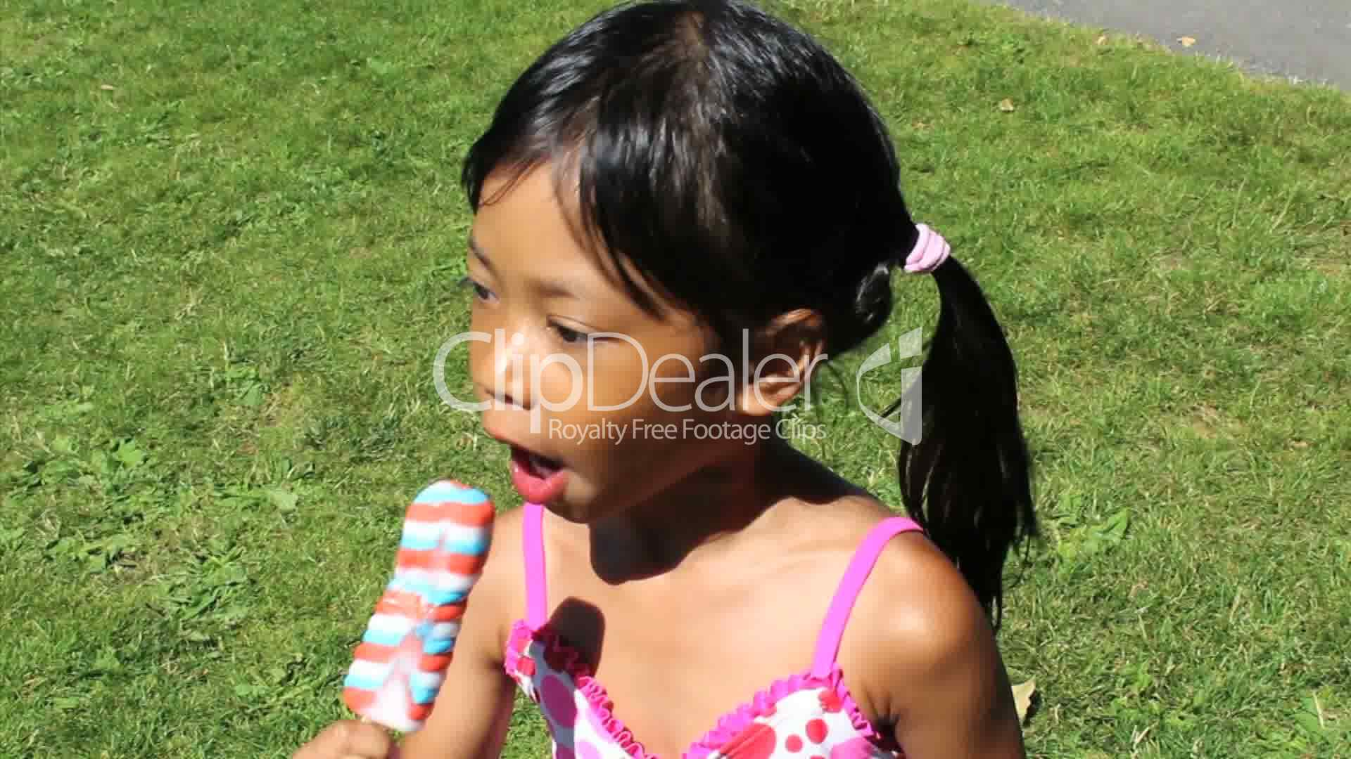 Little Girl Enjoying A Popsicle Royalty Free Video And