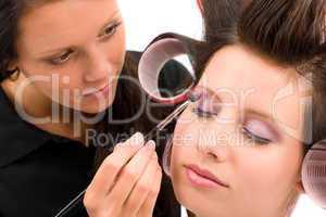 Make-up artist woman fashion model apply eyeshadow