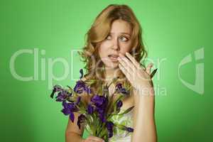 Attractive girl hugging a bouquet of Irises