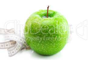 apple with water drops and measure tape isolated on white