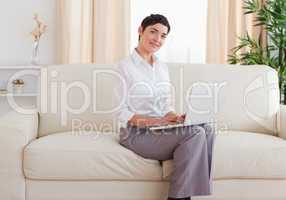 Beautiful short-haired woman with a laptop