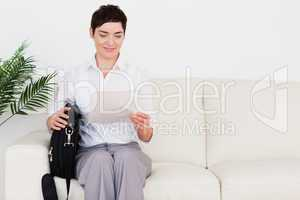 Businesswoman with a paper and a bag