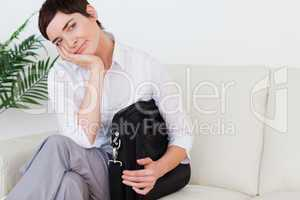 Bored businesswoman sitting on a sofa