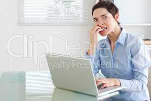 Upset brunette Businesswoman with a laptop