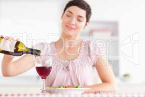 Charming Woman pouring redwine in a glass