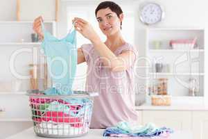 Smiling Woman folding clothes