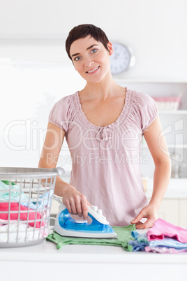 Smiling Woman ironing clothes