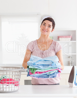 Charming Woman with a pile of clothes