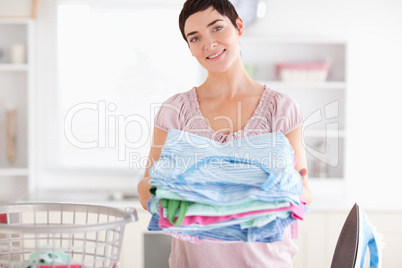 Brunette Woman with a pile of clothes