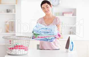 Joyful Woman with a pile of clothes