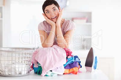 Surprised Woman with a pile of clothes