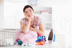 Bored Woman with a pile of clothes