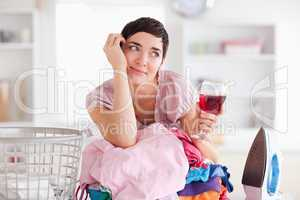 Woman with wine and a pile of clothes