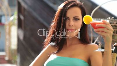 beautiful woman enjoying a cocktail