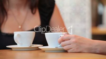Two girls having coffee in Cafe