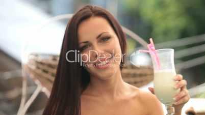 smiling beautiful woman with milkshake