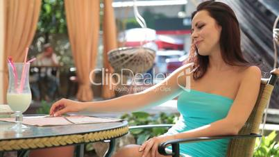 woman in a cocktail dress at a restaurant