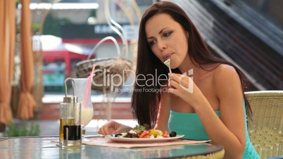 young woman having dinner at a restaurant
