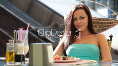 Young Woman Eating Dinner at  Restaurant
