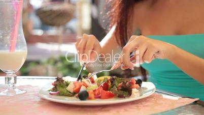 woman eating Greek salad