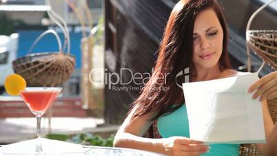 woman reading a letter in the restaurant