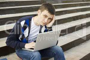 Young student working on a laptop