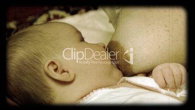 newborn baby breast feeding stylized at reel movie