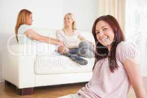 Women chatting on a sofa