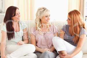 Talking friends sitting on a sofa