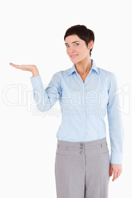 Businesswoman with hand open to show a copy space
