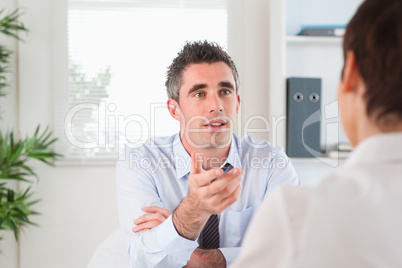 Handsome manager talking to a candidate