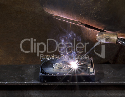 repairing a defect hard disk with welding apparatus