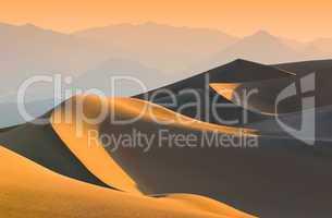sand dunes over sunrise sky