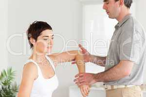 Chiropractor working on a woman's arm
