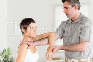 Chiropractor stretching a woman's arm