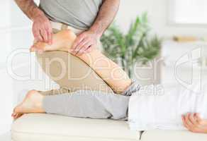 Masseur massaging woman's foot