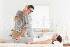 Chiropractor exercising with a woman