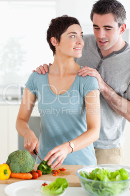 Husband peeking over his wife's shoulder