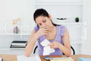 Stressed young woman doing banking