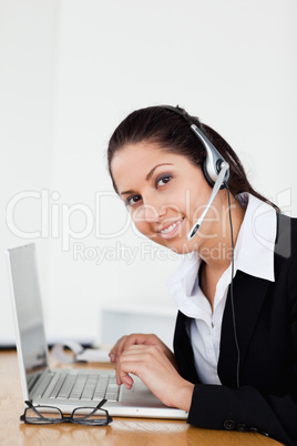 A smiling young operator in her office