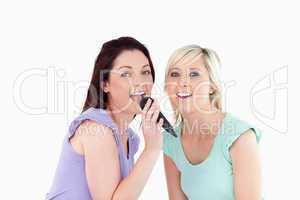 Cheerful Women singing karaoke