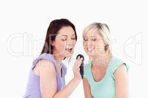 Joyful Women singing karaoke