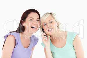 Laughing women on the phone